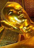 The famous reclinging Buddha at Wat Pho, Bangkok, Thailand.