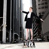 Composite image of business team supporting boss against new york street