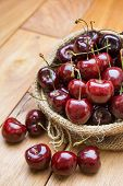 Fresh Red Cherries On Wooden Table
