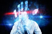 Focused businessman with magnifying glasses against digital security hand print scan