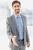 Businessman offering to shake hands at work