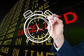 Composite image of business person drawing a white clock