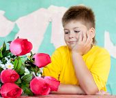 Boy With A Bouquet Of Roses
