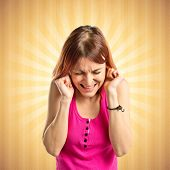 Young Girl Covering Her Ears Over Pop Background