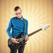 Young Man Playing Guitar Over Pop Background