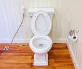 Good Preparing Of Clean, White And Sterile Toilet In A White Wall Bathroom.