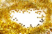 Golden tinsel garland frame and star confetti