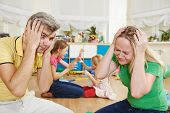 stock photo of fatigue  - parent in confusion state of children bad manners behaviour - JPG