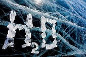 Chemical formula of water H2O made from ice on winter frozen lake Baikal