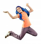Happy Schoolchild Or Traveler Exercising And Jumping