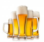 Isolated glasses of beer on white background