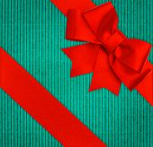 Red Ribbon Bow Over Blue Recycled Cardboard