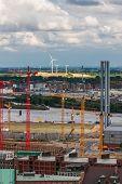 Construction cranes and wind turbines in Hamburg