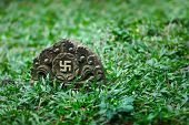 foto of swastika  - Tombstone with the image of ancient symbol  - JPG