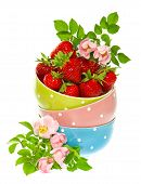 Strawberries And Colorful Bowls With Pink Roses Flowers