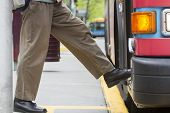 picture of board-walk  - Horizontal Photo of Person Boarding a Bus - JPG