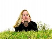 Young Woman Thinking In Grass
