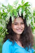 Teen Girl With A Wreath Of Cherry Blossoms On Her Head