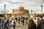 People On The Bridge Of Castel Sant'angelo In Rome, Italy