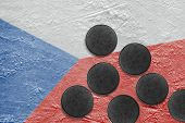 Image of the Czech flag on the ice and washers