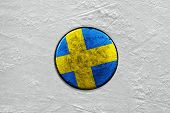 Swedish ice hockey puck on the site. Closeup