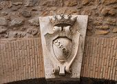 Coat Of Arms On A Gate In The Wall Around The Vatican. Rome, Italy