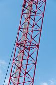 picture of boom-truck  - A Construction crane against the sky fragment - JPG