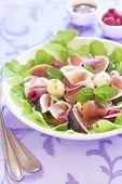Salad with figs, mozzarella, prosciutto and raspberries