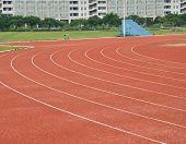 Red plastic runway in a sports ground