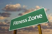 foto of road sign  - Fitness Zone Green Road Sign In Front of Dramatic Clouds and Sky - JPG