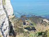 Old Oyster Farm And Cliff On English Channel Beach