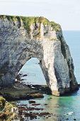 View Of Rock With Arch On English Channel Beach