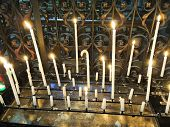 Lighted Candles On Altar Of Cathedral