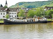 stock photo of moselle  - waterfront Ellenz Poltersdorf village on Moselle river Germany - JPG