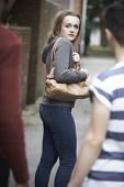 stock photo of she-male  - Teenage Girl Feeling Intimidated As She Walks Home
