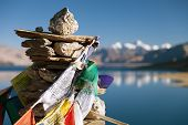 stock photo of indian blue  - Tso Moriri Lake with prayer flags  - JPG