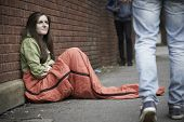 stock photo of sleeping bag  - Vulnerable Teenage Girl Sleeping On The Street - JPG