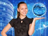 Beautiful businesswoman in dress holding Earth with lines