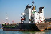 Black Tanker Loading. Industrial Cargo Ship Moored In Burgas