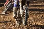 foto of motocross  - Closeup of a motocross bike in a championship - JPG