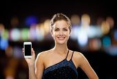 technology, communication, holidays, advertising and people concept - smiling woman in evening dress