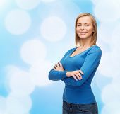 happiness and people concept - smiling young woman in casual clothes