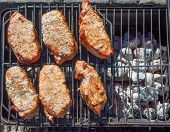 Pork Chops On Charcoal Barbeque