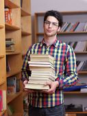 happy young teen boy in school on chemistry classes and library