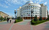 NOVOSIBIRSK, RUSSIA - AUGUST 25, 2014: People walking in front of the headquarter of the West-Siberi