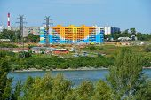 NOVOSIBIRSK, RUSSIA - AUGUST 31, 2014: New residential building on the left bank of Ob river. One mi