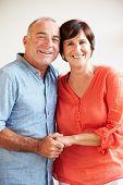 Portrait Of Happy Middle Aged Hispanic Couple