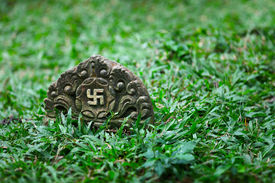 stock photo of swastika  - Tombstone with the image of ancient symbol  - JPG