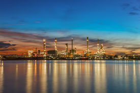 stock photo of refinery  - Oil Refinery Industry Plant Along Twilight Morning - JPG