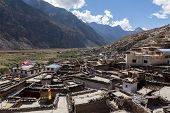 pic of mustang  - Rooftop view over Marpa village - JPG